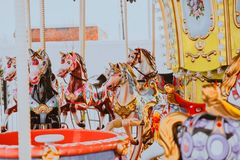 Children`s carousel with horses without children. stock images