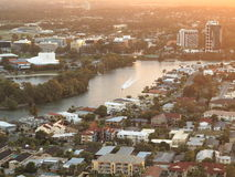 Aerial image of city by river in twilight Royalty Free Stock Image