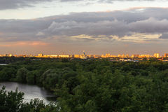 City under the storm clouds at sunset Stock Photography