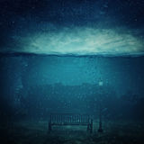 City underwater. Underwater fantasy world. Modern city ruins under the sea and a wooden bench with a street lamp drowned. Adventure and journey concept of marine Stock Photo