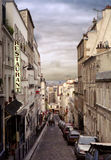 City of untold stories. Old-fashioned shot of narrow street of monmartre in paris, france Royalty Free Stock Image