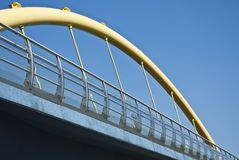 City Urban, Industrial Enviroment with Yellow Pipe. Bridge on Background of Blue Sky stock image