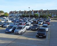 City urban town car park vehicles community. Photo of a large town car park situated in whitstable kent england full of cars sept 2018 stock photography