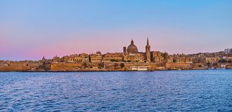 The city of Valletta from Northern Harbour, Malta. Enjoy historic Valletta city from the Northern Harbour, observe its tall belfries, huge domes and historic stock photo