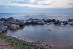 Baltic sea with waves, rocks and blue sky. Summer evening. royalty free stock photography