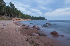 Baltic sea with waves, rocks and blue sky. Summer evening. stock image