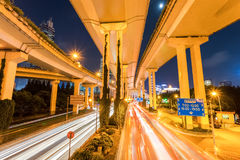 City viaduct closeup at night. City elevated road closeup, under the interchange overpass at night, shanghai, China Royalty Free Stock Images