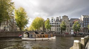 City view of amsterdam with boat Royalty Free Stock Images