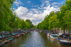 City view of Amsterdam canal with boats, Holland, Netherlands. Stock Photos