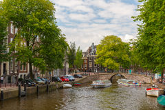 City view of Amsterdam canal, bridge and boats, Holland, Netherl Royalty Free Stock Photos