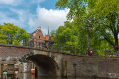 City view of Amsterdam canal, bridge and typical houses, Holland Royalty Free Stock Images