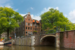 City view of Amsterdam canal, bridge and typical houses, Holland Stock Photo