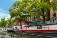 City view of Amsterdam canal and houseboat, Holland, Netherlands. Royalty Free Stock Photo