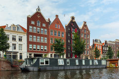 City view of Amsterdam canal and typical houses, Holland, Nether Royalty Free Stock Image