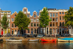 City view of Amsterdam canals. And typical houses, boats and bicycles, Holland, Netherlands Royalty Free Stock Images