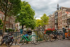 City view of Amsterdam canals and typical houses, Holland, Nethe Stock Photos
