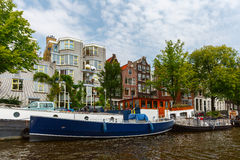 City view of Amsterdam canals and typical houses, Holland, Nethe Stock Photo