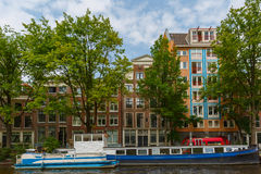 City view of Amsterdam canals and typical houses, Holland, Nethe Stock Image