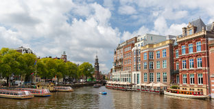 City view of Amsterdam canals and typical houses, Holland, Nethe Stock Photography