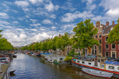 City view of Amsterdam canal and typical houseboats, Holland Stock Images