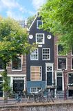 City view of Amsterdam with traditional old town buildings stock images