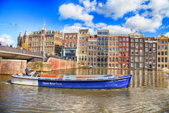 City view of canals, dutch houses and tour boat, Amsterdam, Netherlands. royalty free stock photos