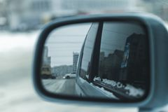 City view in the car mirror stock photography