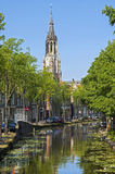 City view of Delft with canal and New Church Tower Stock Images
