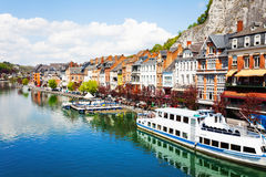 City view of Dinant on Meuse river with ships Royalty Free Stock Photos