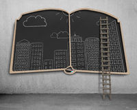 City view doodles on book shape blackboard Stock Images