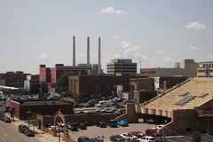 City view. A view of downtown Lansing, with three smokestacks rising in the distance stock photos