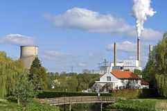 City view with Essent power plant and park. Netherlands, North Brabant province, city Geertruidenberg: part of the factory of the Central Amer. This power plant Stock Images
