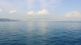 City view from the ferry, beautiful sea. The city looks across stock video footage