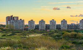 City view with flats from the dunes of Scheveningen a popular and touristic town at the beach in the Netherlands at sundown time. A City view with flats from the royalty free stock images