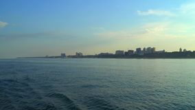 City view with floating sea ship stock footage
