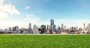 City view with grass lawn, eco-friendly building royalty free stock photo