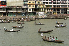 City view of the harbor of the capital Dhaka. Bangladesh: Cityscape of the harbor of the city Dhaka with passenger boats, busy river transport, people and Royalty Free Stock Image