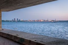 A city view on the horizon across the sea. royalty free stock photo