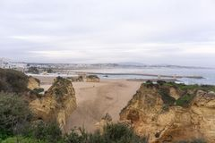 City view of Lagos, Portugal with beach, river and rocks stock images