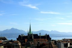 City view of Lausanne. Spire of St Francois Church above the rooftops of Lausanne, Switzerland Stock Images
