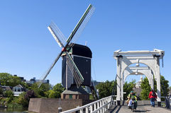 City view Leiden with drawbridge, windmill, people Royalty Free Stock Photo