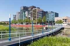 City view of Lelystad with pond and catwalk in the Netherlands Stock Images