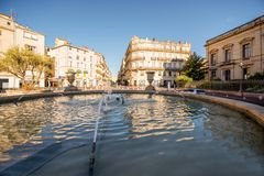 Montpellier city in France. City view on Martyrs square with old buildings and fountain during the morning light in Montpellier city in southern France stock images