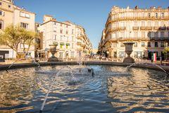 Montpellier city in France. City view on Martyrs square with old buildings and fountain during the morning light in Montpellier city in southern France royalty free stock image
