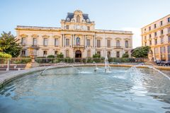 Montpellier city in France. City view on Martyrs square with old buildings and fountain during the morning light in Montpellier city in southern France stock photography