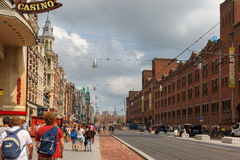 City view of The most famous and crowded Amsterdam street Damrak Royalty Free Stock Images