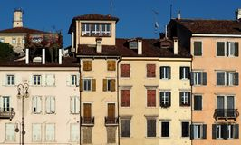 City view of picturesque building facades in the center of Udine, historical capital of Friuli Homeland now in italy.  Royalty Free Stock Photo