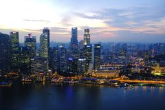 City view: Singapore. Skyscrapers sky cityscape blue sunset above waterline Singapore Stock Photography