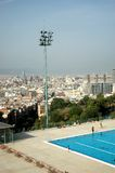City view and swimming pool. Olympic swimming pool in Barcelona Royalty Free Stock Photo