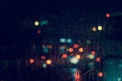 Free City View Through A Window On A Rainy Night Royalty Free Stock Photos - 77410138